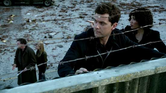 Peter and Astrid look over the fence